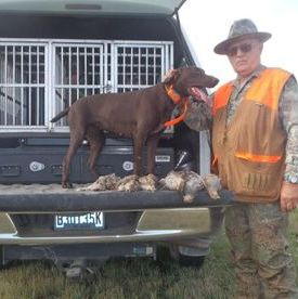 Kent with Cora and huns and sharptail grouse