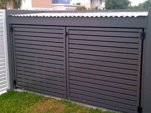 Bin enclosures with gates