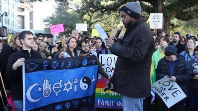 Donney Rose performs at a rally.