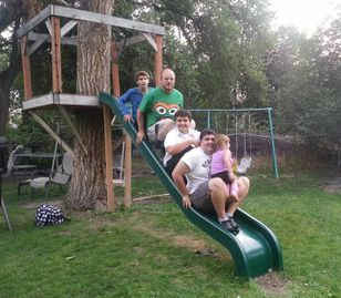 14 ft slide with three people