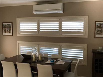 Beautiful shutters in a dining area creates a beautiful setting