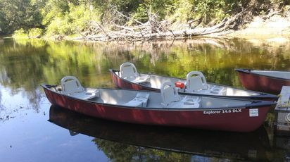 Our deluxe canoes have rod holders and a small cooler