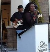 Silkee Smoove Singing to the sounds of their music