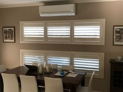 beautiful shutters in an ivory colour sets of the dinning room