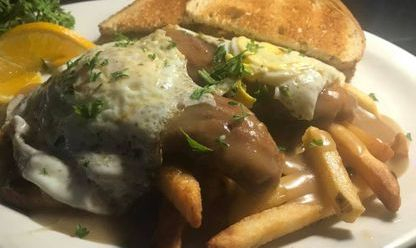 Chicken tenders, fries, turkey gravy and eggs your way