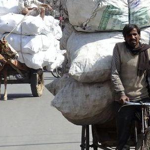 "src=""australian womens travel.jpg alt=womens tours,carryong very big loads on push bikes , India"