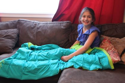 Kate with her Ben's Blanket!  We love the colors we chose and hope it helps her sleep.