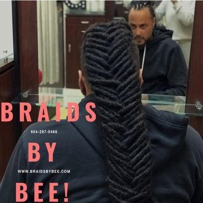Braids By Bee create fishbone braids with dreadlocks