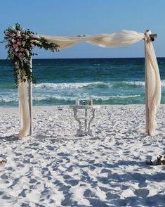 Vintage beach wedding arbor flowers