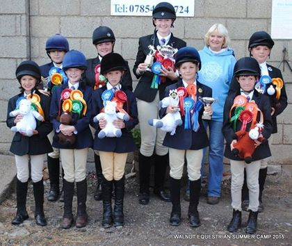 Senior campers with their prizes and knitted ponies