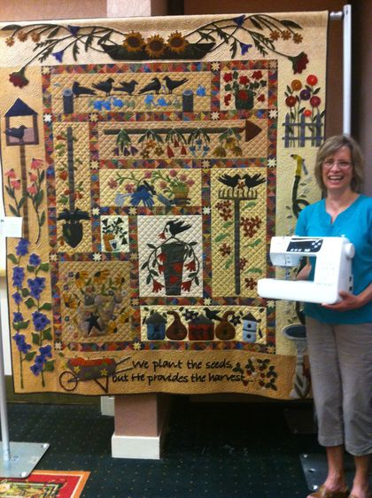 Cathie Shoemaker - A Primitive Garden - Winner of Community Choice!   Janome Machine Winner and will be displayed at A Quilters Gathering 2013