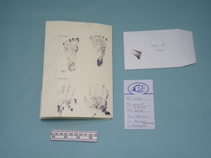 This what we received - a SANDS booklet, a lock of hair, hand and footprints, a cot card, measuring tape and a couple of photographs.