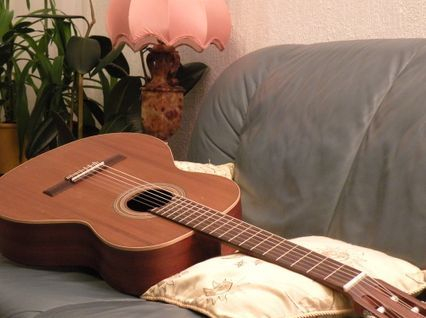 Guitar resting on couch