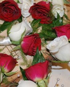 Red and White spray rose boutonnieres