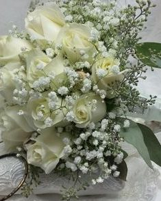bridal bouquet with white roses and baby's breath