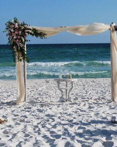 Vintage beach wedding arbor flowers