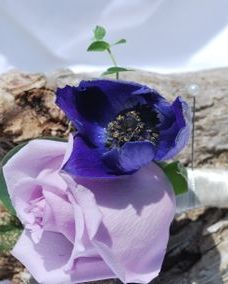 Purple rose with purple anemone boutonniere