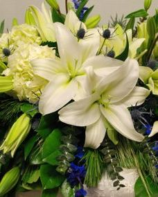 Casket spray with white lilies