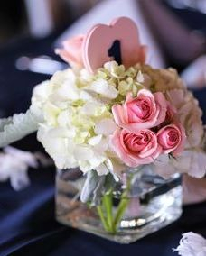 Table centerpiece with white hydrangea and blush spray roses
