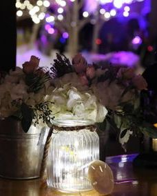 Lighted centerpiece with white hydrangea and blush roses