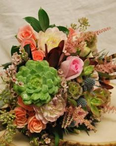 Wildflower bridal bouquet with succulents and pheasant feathers