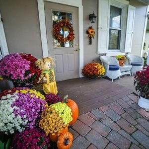 Fall flowers porch  view of Shears 2 You Macungie Organic Salon