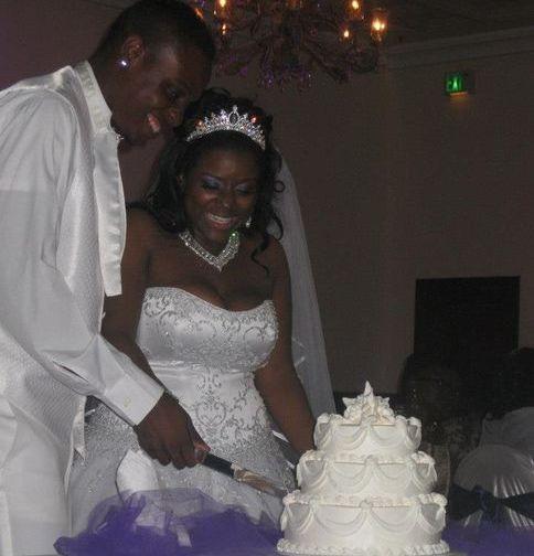 Beautiful Couple Cutting Wedding Cake