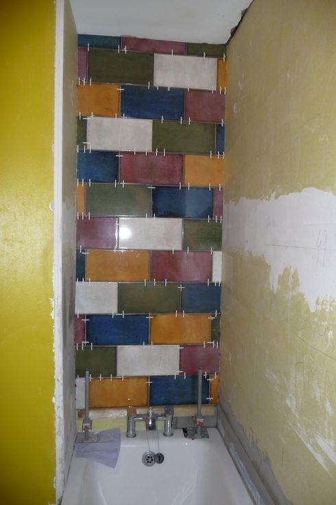 Tiling waterproofed walls