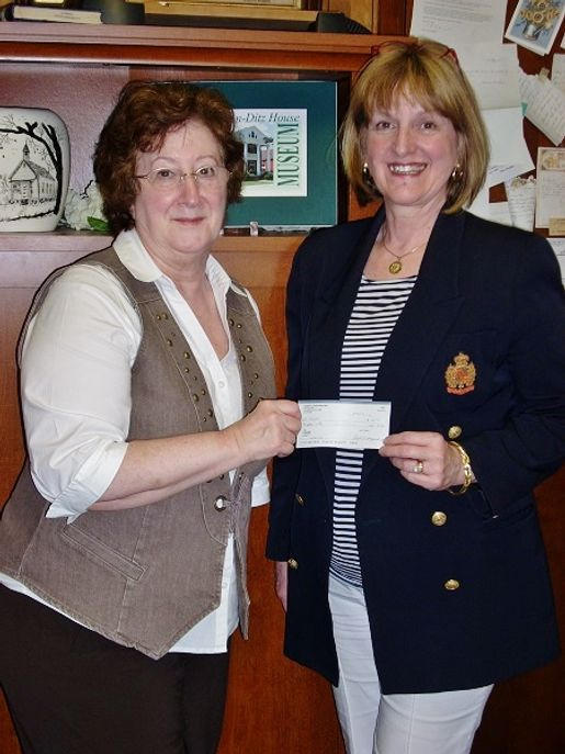 Clarion DAR Regent Betty Elza presents donation to Mary Lea Lucas, CCHS Director/Curator