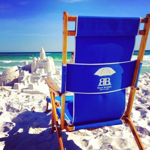 beach chair with sandcastle in background