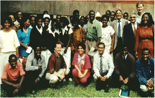 1992: UTZAM team, (University of Texas-University  of Zambia R&D  Project (UTZAM) Standing: Dr Rosemary Sunkutu (extreme right); Prof. Herbert DuPont (second from right), Prof sri Baboo (3rd from right) Prof Alimuddin Zumla (5th from right), Professor Chifumbe Chintu (centre), Dr Francis Kasolo (3rd from left); Prof. Nkandu P Luo (4th from left) Sitting: (Late) Prof Ganapati Bhat (3rd from right)