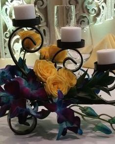 Bom Blue dendrobium orchid and yellow spray rose centerpiece