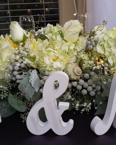 Sweet heart table arrangement with roses, hydrangeas and silver brunia