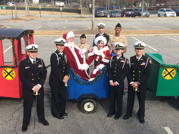 Senior Cadets take time to pose with Mr. & Mrs. Claus at the Santa Parade in Downtown Kennesaw, Saturday, 2 December 2017.