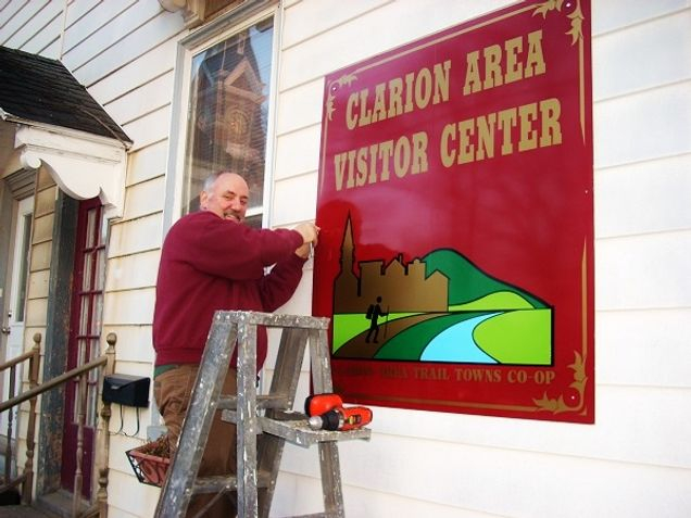 Tom Zeller installing sign at the CCHS Milo Markle Annex.