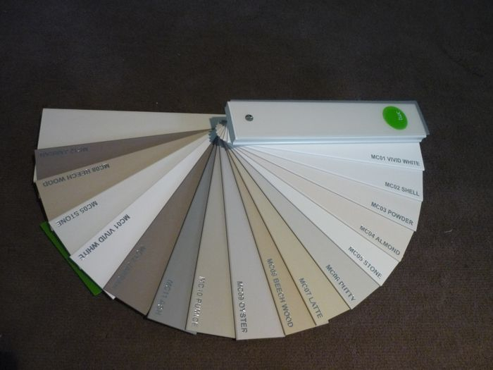 Venetian blinds in shades of white & timber colours also