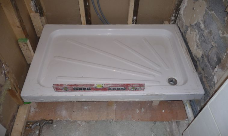 Shower tray reinstalled