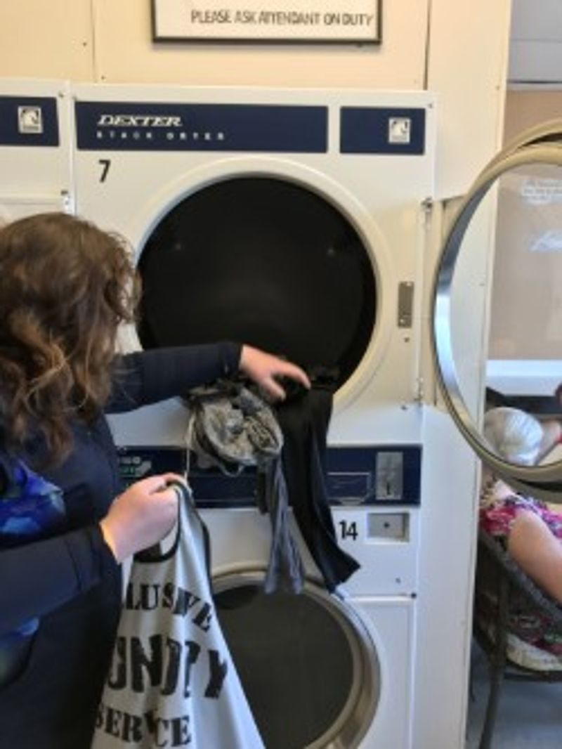 Learning to do laundry at a local laundry matt