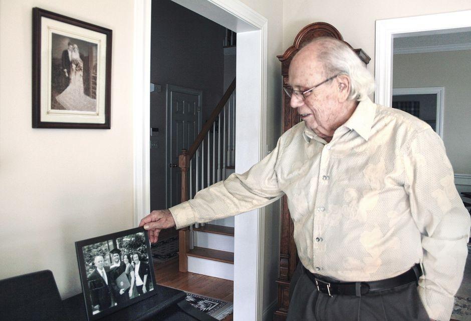 E. Richard Fortunato admires family photos.